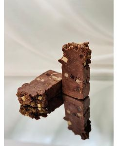 Chocolate brownie with candied fruit pieces and rich chocolate-vanilla aroma.